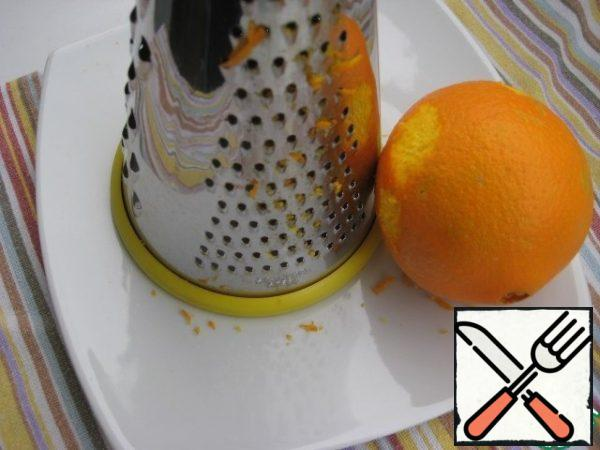 Grate the orange zest on a small grater, I took 1/3 of the whole.