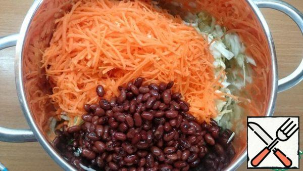 Add beans to carrots and cabbage.