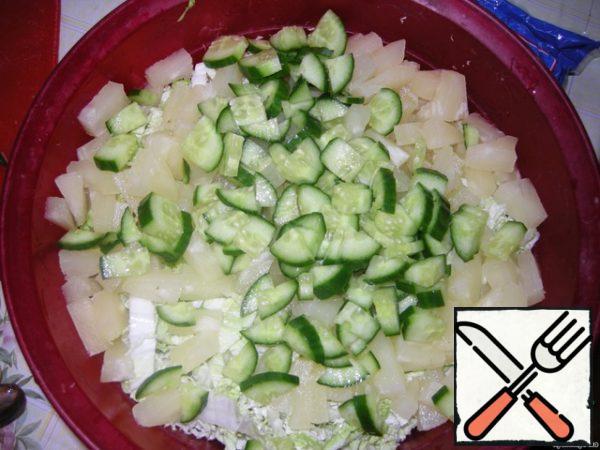 Add the chopped cucumber.
