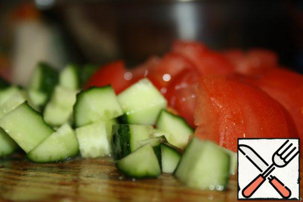 Tomatoes and cucumbers, cut as well, not very finely.