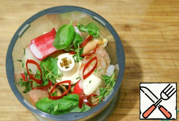 Seafood, crab sticks, garlic, chili rings, Basil and thyme leaves roughly enough to chop/chop with a knife/using a blender/chopper.