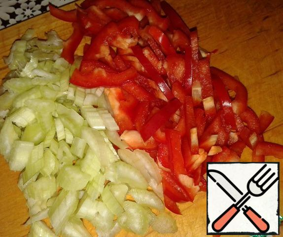 Cut celery and bell pepper into strips.