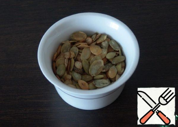Fry pumpkin seeds in a dry pan.