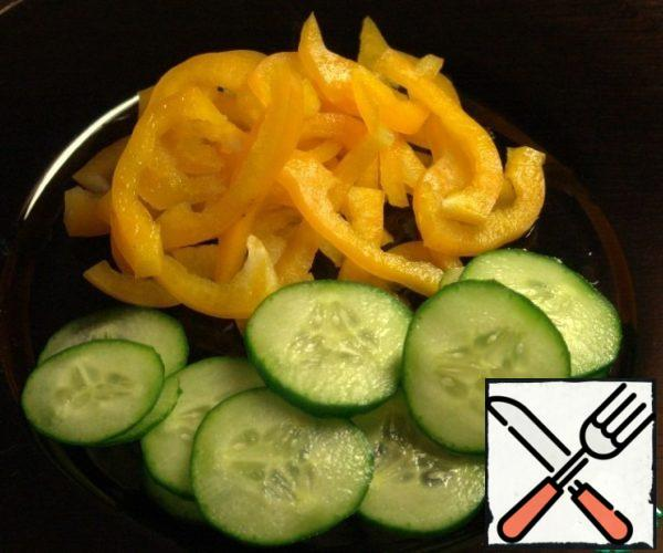 Cucumber cut into slices, pepper straws.