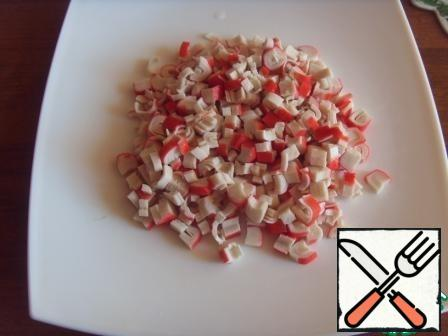 Cut crab sticks, not very finely.