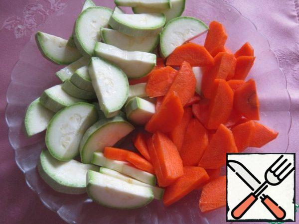Zucchini and carrots cut into semicircles.