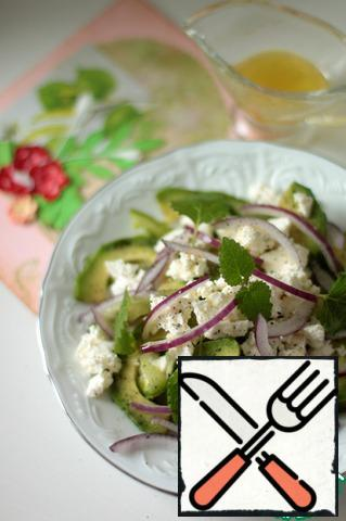Decorate the salad with mint leaves. Prepare the sauce: squeeze half a lime, add olive oil, salt and pepper.