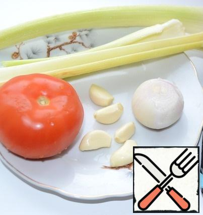 While fish broth is cooking let's do vegetables for soup. Onions, celery, garlic and tomatoes cut into cubes.