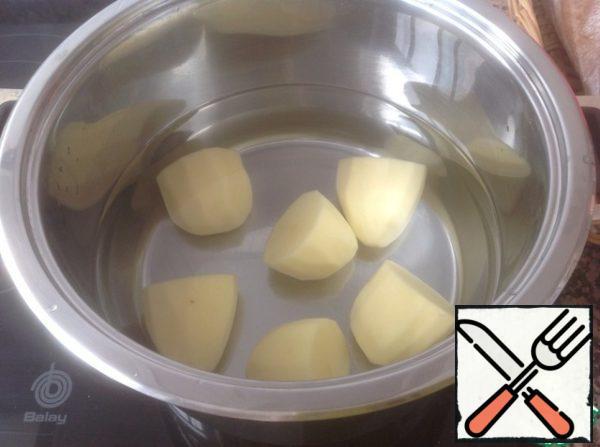 Cook potatoes until tender.