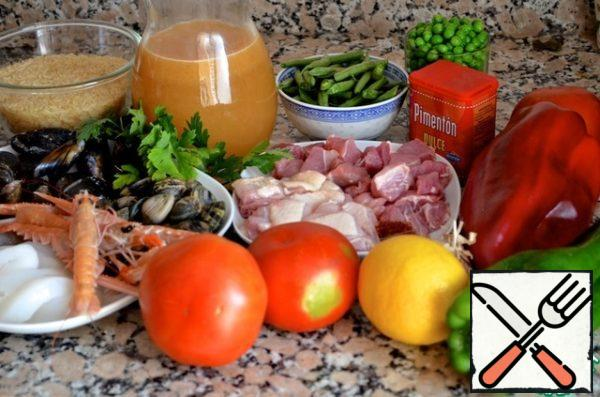 "Important ingredients: olive oil (cold pressed, with mild taste), saffron and sweet paprika. Paella can be fish, meat, vegetable or mixed – there is a huge scope for imagination. Most often, the Spaniards add mushrooms, artichokes, green beans, snails, shrimp, cuttlefish, squid, mussels, rabbit, pork, chicken - in different combinations. The following is a recipe for paella with seafood and meat-Paella al estilo mar y tierra (paella in the style of ""Sea and land»"