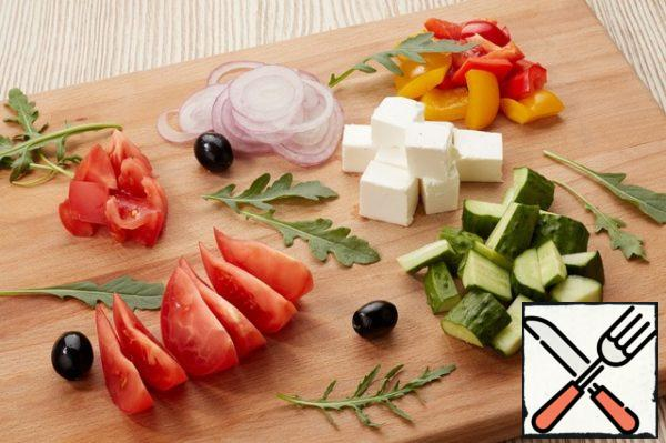 Cut into large all vegetables and put on a plate. Big cubes cut the feta cheese and lay around the vegetables.