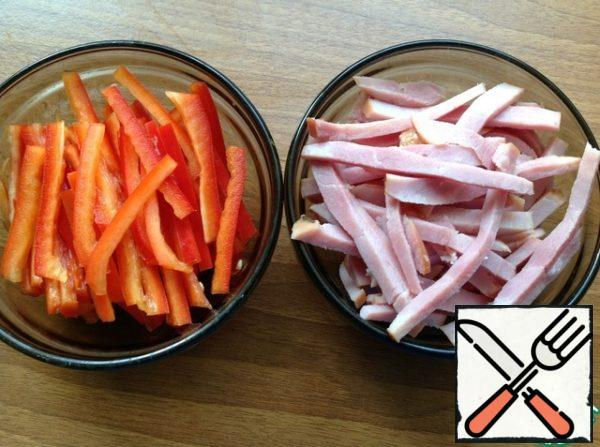 Pepper and ham cut into thin strips.