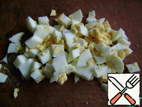 Cook the egg and cut into cubes.