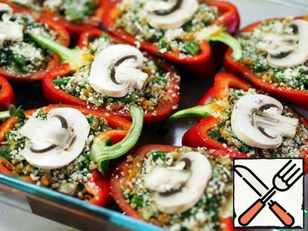 Turn the oven to 200 degrees. Fill our peppers with stuffing and put in a preheated oven for 35-40 minutes, until soft pepper. True, I had a great-o-e desire to eat them right without baking. I think that in raw form you can serve these peppers as a cold snack.