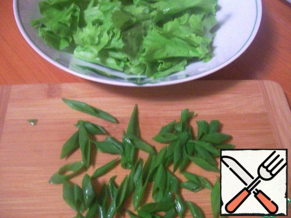 The green of the lettuce to break it into fairly large pieces. Onions cut feathers, dill cut very finely.