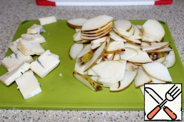 Cheese and pear cut into small thin plates.