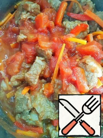 Add fried or pureed tomatoes, simmer, stirring, another minute or two.