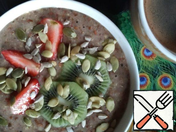 Delicious and healthy Breakfast is ready! Shift into a bowl, decorated with pieces of fruit and seeds.
