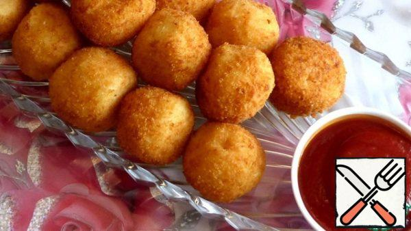 Tasty and tender snack-potato balls with cheese-ready. Served with ketchup. And I wish You Bon appetit, good mood and all the best!