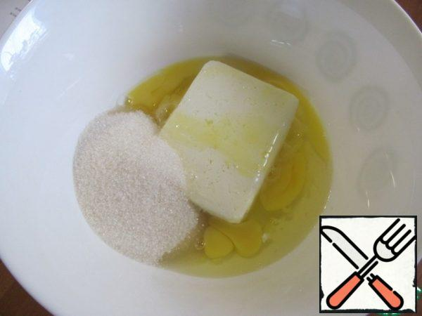In a bowl mix cottage cheese, eggs and sugar, beat with a whisk or mixer.