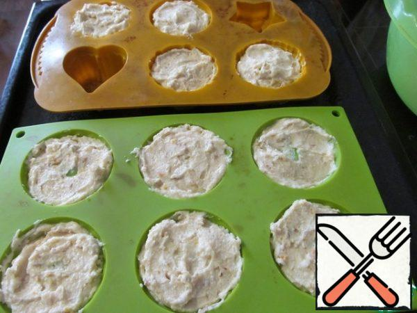 Take forms for muffins ( I have silicone, do not grease), and a spoon to put the dough almost to the edges, it will rise not much. I made 10 cupcakes out of that portion. Put in a preheated 180C oven for 30-35 minutes. Focus on a light blush, do not overdo it!