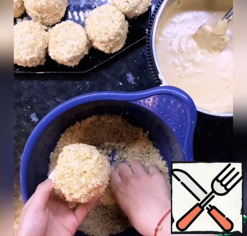 Collect cake ( dip up one part of the finished dough in the cream, cover the second part, dip the cake in the cream and roll in the crumbs). Bon appetit!