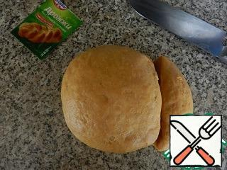 Punch down the risen dough, to cut away the small piece (required for registration). The rest of the dough is divided into 2 parts.