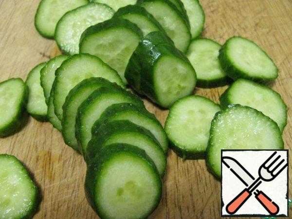 Fresh cucumber cut into slices and sprinkle with salt.