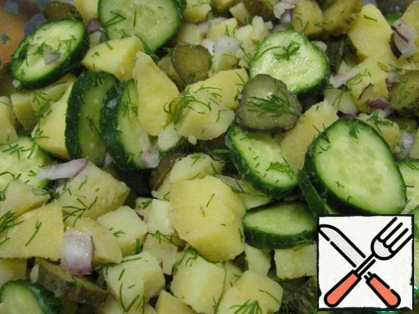 Mix fresh cucumber, onion, pickles, potatoes and half of dill.