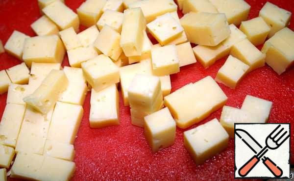 Cheese cut into small cubes. Put into salad and mix.