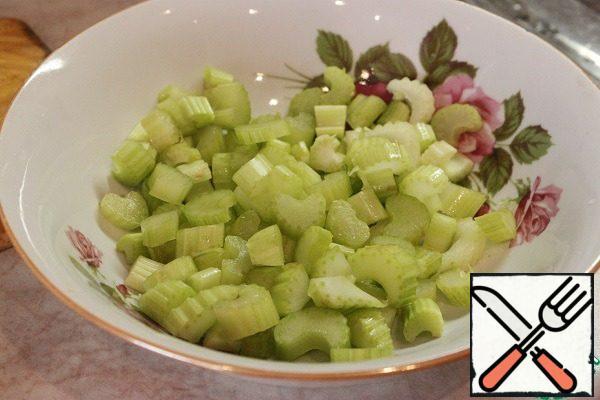 Celery cut into half-rings.