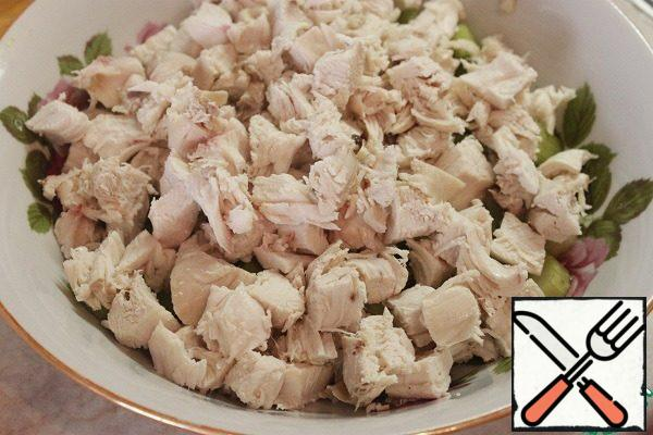 Boiled chicken breast cut into cubes.