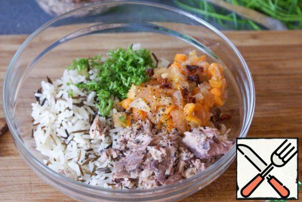 Mix together rice, mashed tuna, parsley, finely chopped dried tomatoes and the contents of the pan.