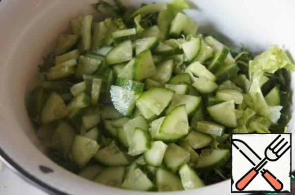 Cucumber cut into slices and add to salad.