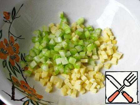 Celery and cheese cut into small cubes.