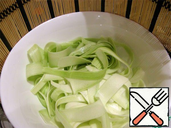Zucchini cut into thin ribbons.