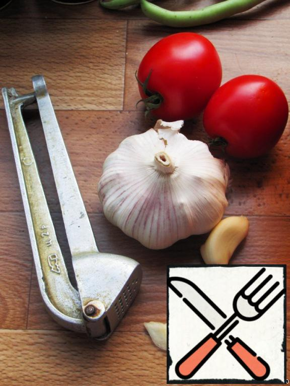 Garlic is passed through the press and add with salt, pepper mixture, vinegar and water.
