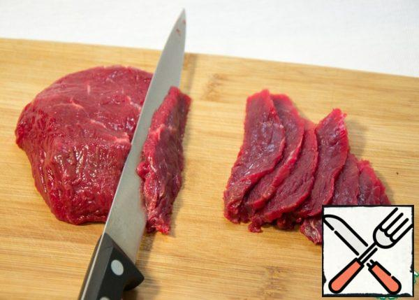 Beef cut into sharp fillet knife in translucent slices.