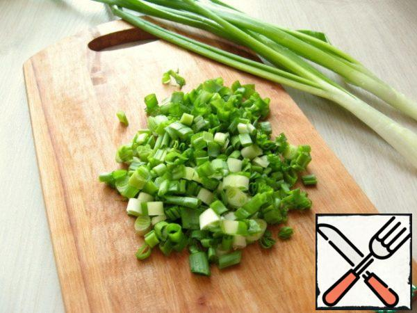 Finely chopped spring onions.