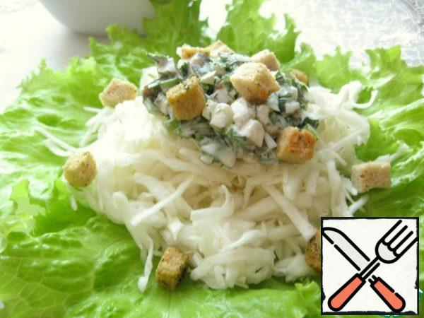 Salad serve portions. On a plate put the lettuce, the mound the cabbage, add dressing and sprinkle with croutons.