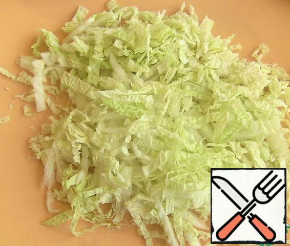 Finely chop the cabbage.