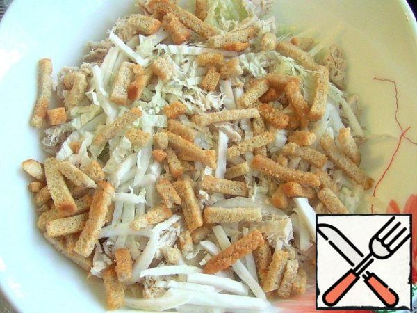 Stir chicken fillet with cabbage, add a little mayonnaise, stir. Before serving, sprinkle with crackers.