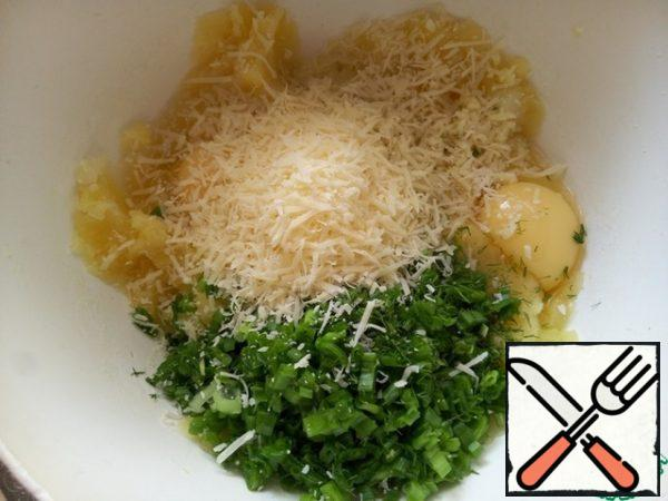 Season with salt and pepper, add eggs, grated Parmesan, chopped garlic clove, chopped herbs and green onions.