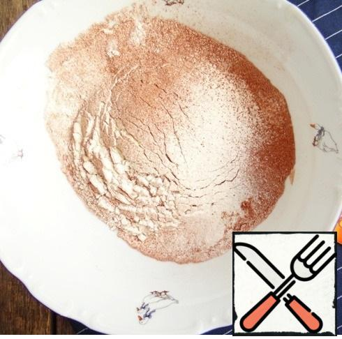 Glass - 240 ml Sift flour with cocoa powder and baking powder.