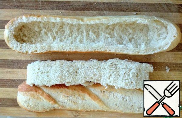 With baguette cut the top and remove the crumb.