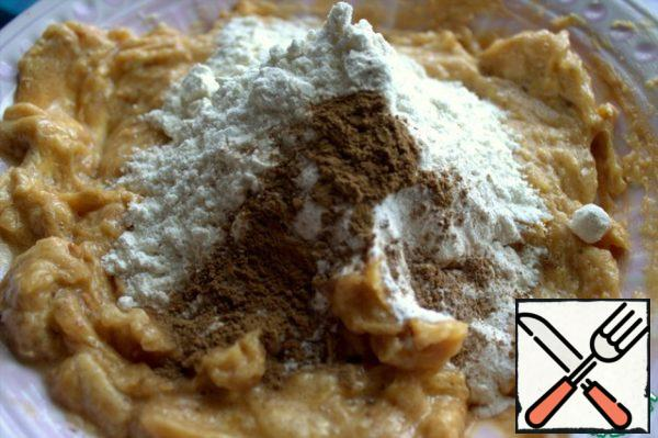 Mix with egg and add flour with baking soda, baking powder and cinnamon.