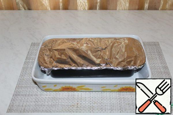 Put in a large baking dish, pour boiling water, it should reach half the height of the form with terrine.