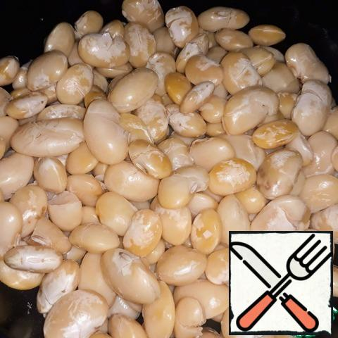 Soak the beans for 12 hours. Then boil until cooked (In my case, large white beans cooked a little more than an hour);