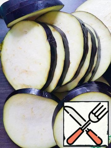 Eggplant cut into slices about 4-5 mm thick.