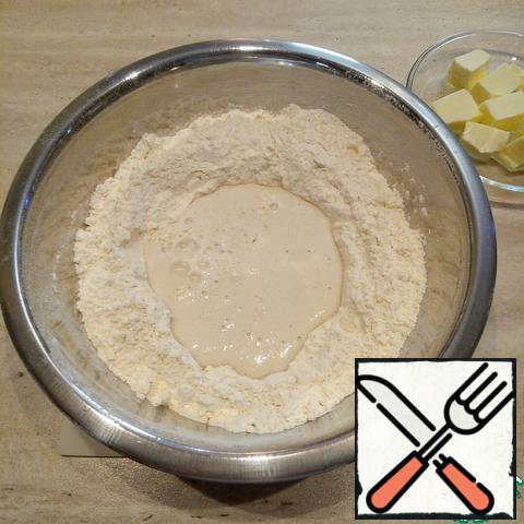 Add salt, sugar and mix into the sifted flour. Pour in the yeast, warm milk and start kneading the dough.